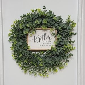 Wreath and wood sign